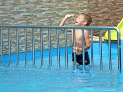 Separated pool for children with slide